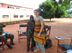 Beninese Cadet Dossou wraps ROTC Cadet Aria Penatzer in a traditional Beninese wrap.