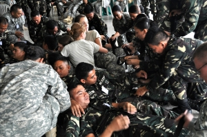 U.S. ROTC Cadets and members of the Philippine Armed Forces stage a mass casualty pile so personnel can practice finding and applying tourniquets.   The Cadets were mostly nursing students and were able to help the Guam National Guard with its State Partnership Program mission, which was to train the Philippine Armed Forces in emergency response techniques.