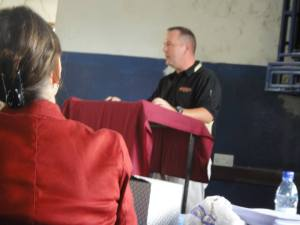 Lt. Col. Ed Pethan,  a professor of military education for U.S Army Cadet Command and mission commander for the CULP mission, speaks of his three important points to teaching success at the first Tanzanian English workshop at  Jitegemee Secondary School in Tanzania.