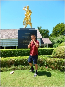 Cadet Oh  posing in front of the memorial Muay Thai statue in the Bangsai Arts Centre in Ayutthaya, Thailand.