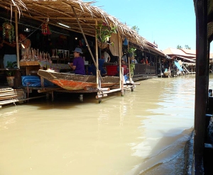 The floating market was a market place that was on the water and visitors shopped by rowing a boat up to each stall.