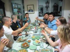 Thai pilot Capt. Koom is enjoying a traditional Thai dinner with the Cadets, who he just talked into having a pepper contest. Over the course of dinner the cadets learned about the many facets of Thai Culture; and needless to say, how hot, hot peppers can really be.